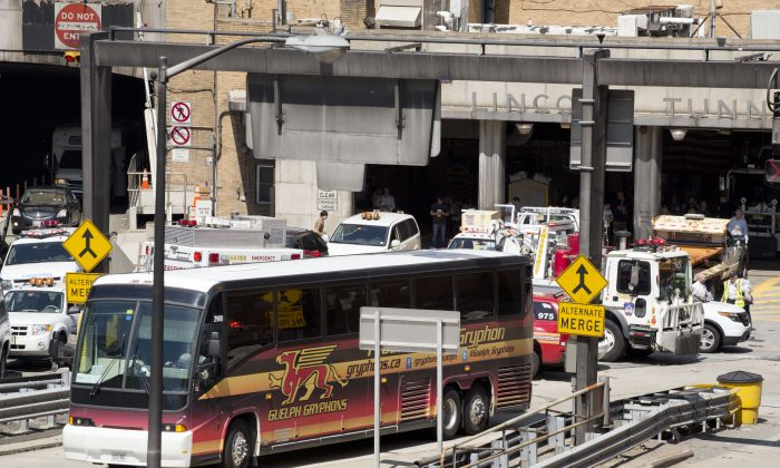 A private bus that had been carrying Canadian school children drives out of the Lincoln Tunnel, Wednesday, June 10, 2015 in New York. (AP Photo/Mark Lennihan)