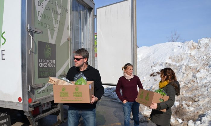 Workers with Really Local Harvest deliver fresh produce. Really Local Harvest is a food hub in New Brunswick that aggregates products from 30 local producers and distributes them to consumers, restaurants, and schools. (Courtesy Really Local Harvest)