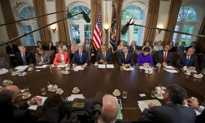 President Barack Obama speaks to the media while meeting with members of the cabinet in the Cabinet Room of the White House in Washington, Thursday, May 21, 2015. (AP/Pablo Martinez Monsivais)