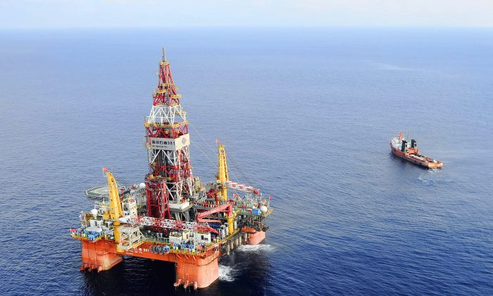 Haiyang Shiyou oil rig, the first deep-water drilling rig developed in China, is in the South China Sea on May 7, 2012. (Xinhua, Jin Liangkuai/AP)