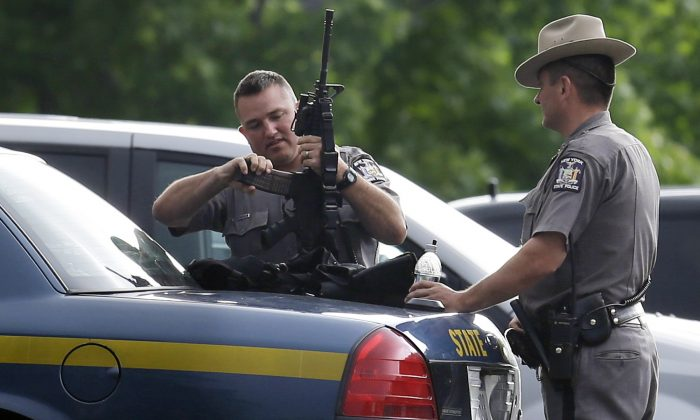 New York State Police prepare their equipment during a search for two escaped prisoners near Dannemora, N.Y., Thursday, June 11, 2015. (AP Photo/Seth Wenig)