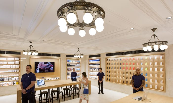 The accessories room is decorated with reproduction chandeliers at Apple's new store on New York's Upper East Side, Thursday, June 11, 2015.  (AP Photo/Mark Lennihan)