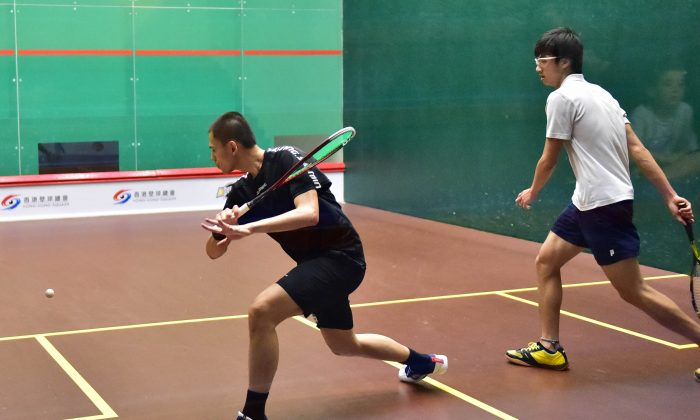 Max Lee Ho Yin playing against Yuen Tsun Hei in the quarter final of the Hong Kong National Championships at the Hong Kong Squash Centre on Thursday June 11, 2015. Lee won in 4-games 11-5, 10-12, 11-9, 11-7 to move on to play Wong Chi Him in the semi-final on Friday June 12. (Bill Cox/Epoch Times)