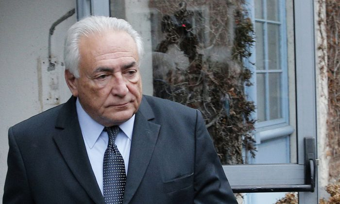 former Managing Director of International Monetary Fund Dominique Strauss Kahn  leaving his hotel in Lille, northern France, as he goes on trial for sex charges at a court. Dominique Strauss-Kahn faces a verdict Friday in the last of a string of legal cases that started when a New York hotel maid accused him of sexual assault in 2011. (AP Photo/Christophe Ena)