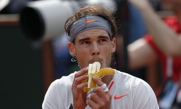 Spain's Rafael Nadal eats a banana during a time-out (Thomas Coex/AFP/Getty Images)
