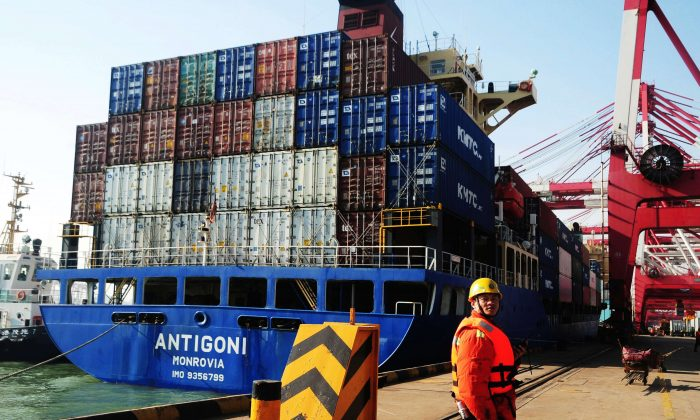 A cargo ship is preparing to leave the Qingdao port in China, March 7, 2014 (STR/AFP/Getty Images)