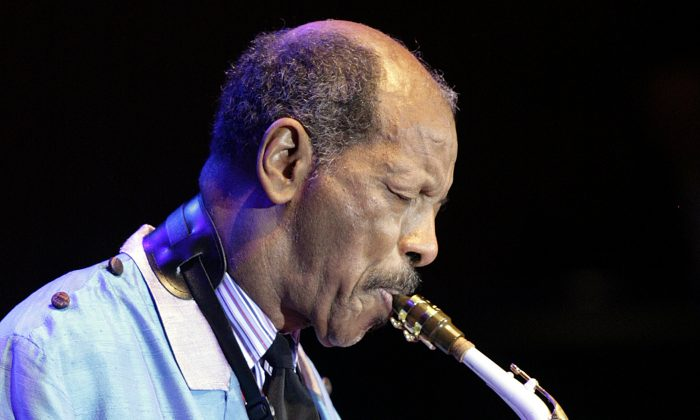FILE - In this Wednesday, Feb. 14, 2007, file photo, U.S. jazz legend Ornette Coleman plays the sax during his only concert in Germany at the philharmonic concert house in Essen, Germany. (AP Photo/Martin Meissner, File)