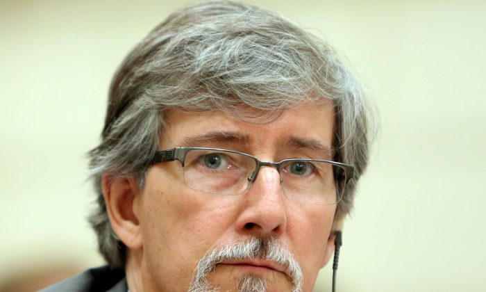 Privacy Commissioner Daniel Therrien waits before appearing at the Commons human rights committee on Parliament Hill June 10, 2014. Upon releasing his annnual privacy report this week, Therrien said said 2014 was a landmark year for international collaboration on privacy. (The Canadian Press/Fred Chartrand)