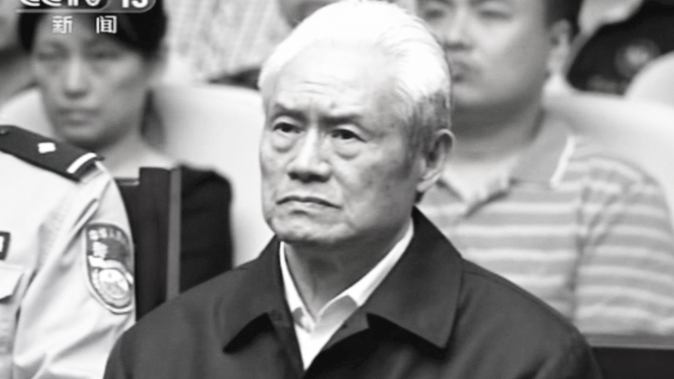 Zhou Yongkang, formerly the Chinese Communist Party Politburo Standing Committee member in charge of security, sits in a courtroom at the First Intermediate People's Court of Tianjin in Tianjin, China, on June 11, 2015. Zhou was sentenced to life in prison. (CCTV via AP)