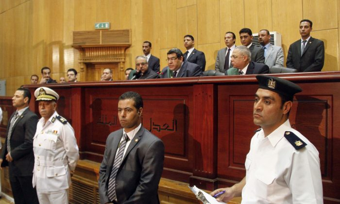 Egyptian Judge Shaaban el-Shami, center, sentences ousted Egyptian President Mohammed Morsi to death over his part in a mass prison break that took place during the 2011 uprising that toppled Hosni Mubarak, in a converted lecture hall in the national police academy in an eastern Cairo suburb, Egypt, Saturday, May 16, 2015.  (AP Photo/Ravy Shaker, El Shorouk newspaper)