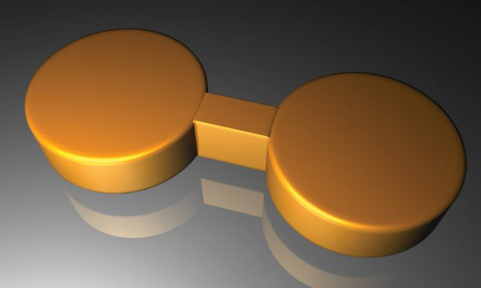 This artist's rendering depicts a pair of gold nanodisks linked by a gold bridge. (Fangfang Wen/Rice University)