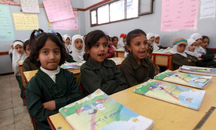 Yemeni schoolgirls attend a class on Feb. 26 at a school in the capital Sanaa. About 76 percent of Yemen's schools have been closed due to the fighting there. (MOHAMMED HUWAIS/AFP/Getty Images)