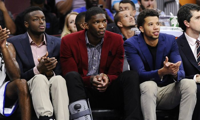 Philadelphia 76ers center Joel Embiid (C), is flanked by teammates Jerami Grant (L) and Michael Carter-Williams. Embiid missed all of the 2014–15 season with a right foot stress fracture. (AP Photo/Michael Perez)