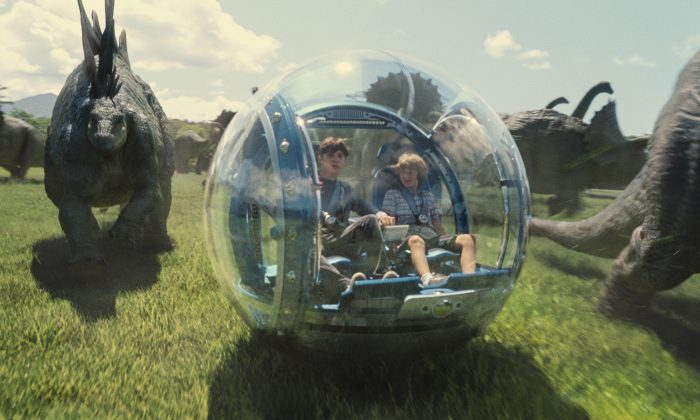 """This photo provided by Universal Pictures shows, Nick Robinson (L) as Zach, and Ty Simpkins as Gray, in a scene from the film, """"Jurassic World,"""" directed by Colin Trevorrow, in the next installment of Steven Spielberg's groundbreaking """"Jurassic Park"""" series."""