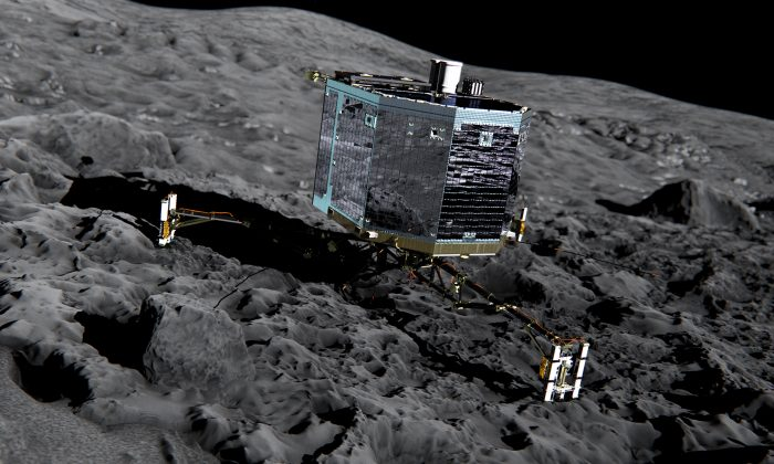 This artist impression from Dec. 2013 by ESA /ATG medialab , publicly provided by the European Space Agency, ESA, shows Rosetta's lander Philae (front view) on the surface of comet 67P/Churyumov-Gerasimenko.  (ESA/ATG medialab/ESA via AP)