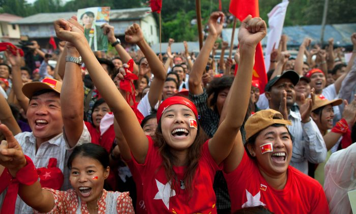 National League for Democracy (NLD) supporters celebrate their victory in the parliamentary elections outside the party headquarters in Yangon, Burma, on April 1, 2012. (Paula Bronstein/Getty Images)