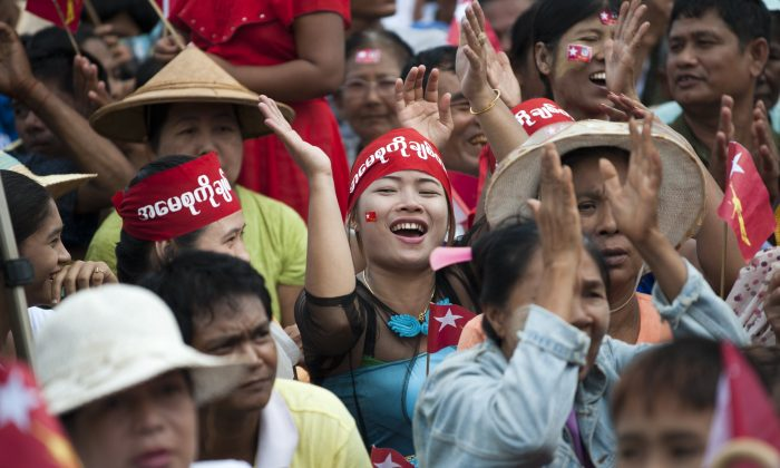 Supporters of Burma opposition leader Aung San Suu Kyi cheer as they attend a public gathering at Than Phyu Zayat township in Mawlamyaing, Mon State, Burma, on May 17, 2015. (Ye Aung Thu/AFP/Getty Images)