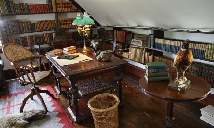 "In this June 9, 2015, photo, a third-story alcove in Theodore Roosevelt's ""gun room"" contains the president's favorite desk, one where he wrote and dictated to his secretary at Sagamore Hill, his summer White House in Oyster Bay, N.Y. (AP Photo/Kathy Willens)"