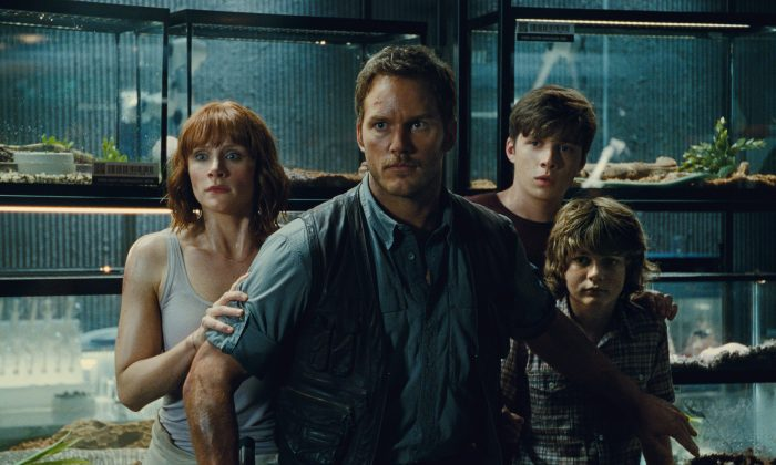 "(L to R) Claire (Bryce Dallas Howard), Owen (Chris Pratt), Zach (Nick Robinson) and Gray (Ty Simpkins) watch in terror in ""Jurassic World"" (Universal Pictures/Amblin Entertainment)"