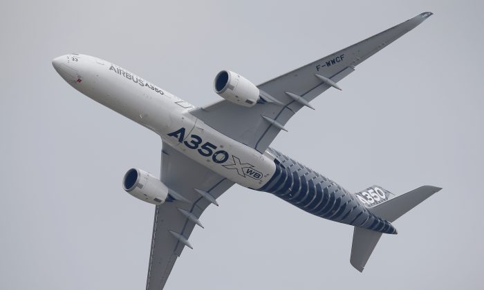 An Airbus A350 performs its demonstration flight during the Paris Air Show, at Le Bourget airport, north of Paris, Monday, June 15, 2015. Some 300,000 aviation professionals and spectators are expected at this week's Paris Air Show, coming from around the world to make business deals and see dramatic displays of aeronautic prowess and the latest air and space technology. (AP Photo/Francois Mori)
