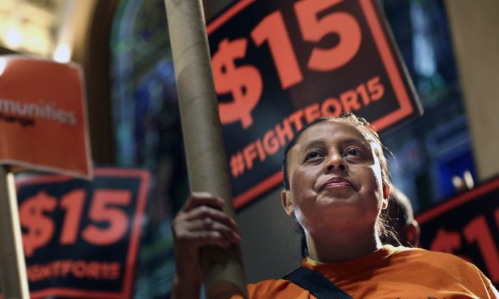 Demonstrators rally for a $15 minimum wage before a meeting of the wage board in New York. (Seth Wenig)