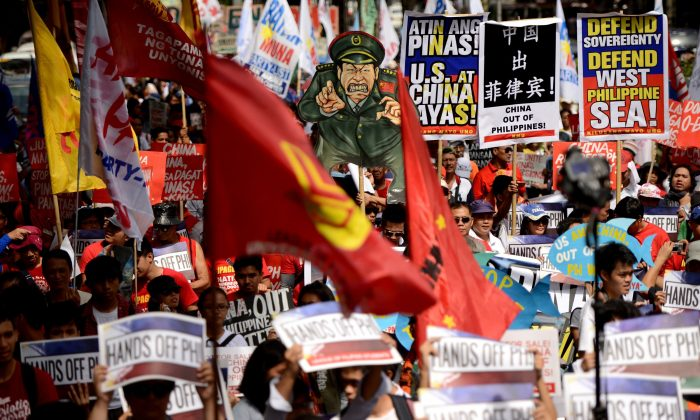 Activists hold a protest in front of the Chinese Consular Office in Manila on June 12, 2015, as the country commemorates the 117th anniversary of the Philippines' declaration of independence from Spain. (Noel Celis/AFP/Getty Images)