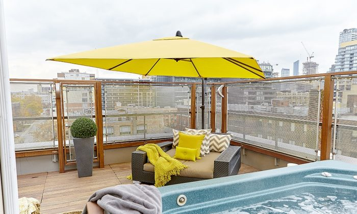 A rooftop patio is decorated to maximize its functionality for entertaining. (To the Point Media)