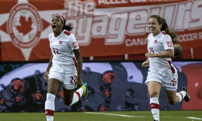 Canadian midfielder Ashley Lawrence (L) celebrates her goal against Netherlands along with teammate Allysha Chapman in FIFA Women's World Cup action on June 15, 2015 in Montreal. (The Canadian Press/Paul Chiasson)