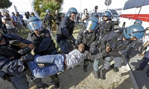 Police in Helmets Drag Migrants From French-Italian Border