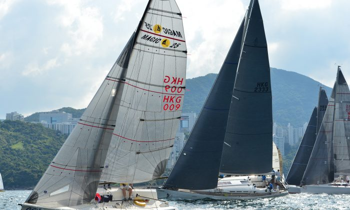 IRC and Sportsboat divisions set off on Race-2 of the Summer Saturday Series on Saturday June 13, 2015. 'Lighthorse' (Sail HKG 2333) won double line honours and double first places in the first two races of the series of 9-races in total, running through to August 8, 2015. (Bill Cox/Epoch Times)