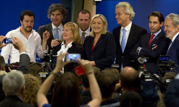 French far right party, Front national, President Marine Le Pen, center right, poses with other members of the far right after a media conference at the European Parliament in Brussels on Tuesday, June 16, 2015. The far right parties in the European Parliament say they have mustered enough unity to form a political group in the European Parliament under the leadership of France's National Front of Marine Le Pen. (AP/Virginia Mayo)