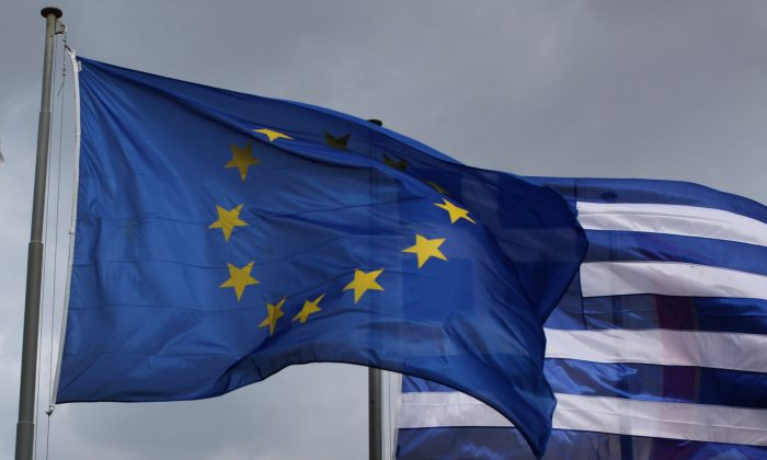 The EU and Greek flags fly in front of the Parthenon on the Acropolis on February 17, 2012 in Athens, Greece. (Oli Scarff/Getty Images)