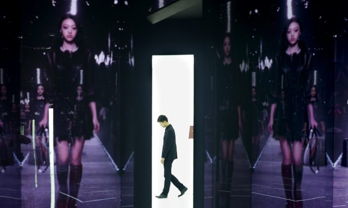 A man walks past a showroom exhibition by French luxury brand Louis Vuitton in Beijing on April 9, 2015.  China is widely considered the world's biggest luxury market as a rising middle class and corrupt officials drive a shopping frenzy, but domestic prices are high due to hefty import taxes and huge retail mark-ups. (Wang Zhao/AFP/Getty Images)