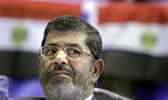 Mohammed Morsi, then the Muslim Brotherhood's presidential candidate, listens during a campaigning conference in Cairo, Egypt. On Tuesday, June 16, 2015 an Egyptian court confirmed a death sentence handed to ousted Islamist President Mohammed Morsi over a mass prison break during the 2011 uprising that eventually brought him to power. On Tuesday a separate ruling upheld a life sentence for Morsi and confirmed death sentences against 16 others over charges of conspiring with foreign groups, including the Palestinian militant group Hamas. (AP/Amr Nabil)