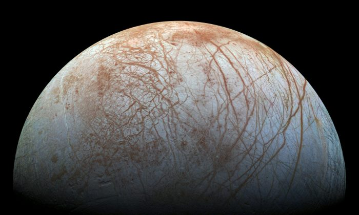 """On Europa it won't just be a lake. There's an ocean that goes around the entire sphere and there may be more water in that ocean than in our oceans. Maybe twice as much. We want to know exactly where that ocean is,"" says William McKinnon. (NASA/JPL-Caltech/SETI Institute)"