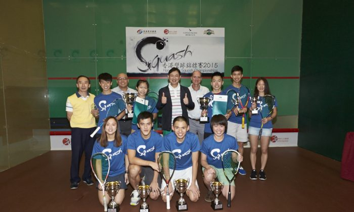 David Y Y Mui, MH, JP, Chairman of Hong Kong Squash (C) together with Cup winners and organisers of the Hong Kong Squash Championship 2015 after the final at the Hong Kong Squash Centre on Saturday June 13. (HK Squash)