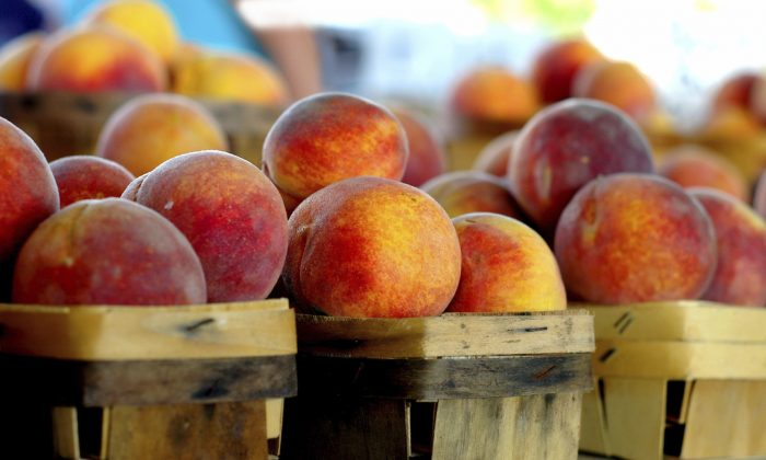 Peaches can lower cholesterol, protect skin from UV rays, and improve digestion.(Zimmytws/iStock)