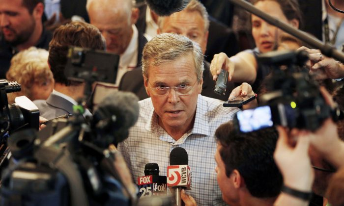 Republican presidential candidate, former Florida Gov. Jeb Bush talks to members of the media after speaking to voters at the Derry Opera House, Tuesday, June 16, 2015, in Derry, N.H. (AP Photo/Jim Cole)