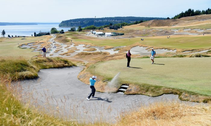 Michael Davan of the United States plays a bunker shot during a practice round prior to the start of the 115th U.S. Open Championship at Chambers Bay on June 16, 2015 in University Place, Washington. (Harry How/Getty Images)