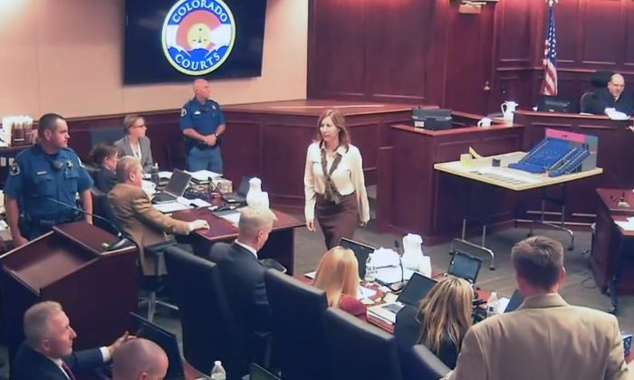 In this image taken from video, Colorado theater shooter James Holmes' former psychiatrist Dr. Lynne Fenton, center, exits the courtroom after testifying in the Holmes trial, in Centennial, Colo., Tuesday, June 16, 2015. (Colorado Judicial Department via AP, Pool)