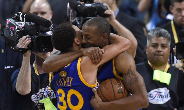 The Golden State Warriors rode regular season MVP Stephen Curry (L) and Finals MVP Andre Iguodala (R) to their first title since 1975. (Timothy A. Clary/AFP/Getty Images)