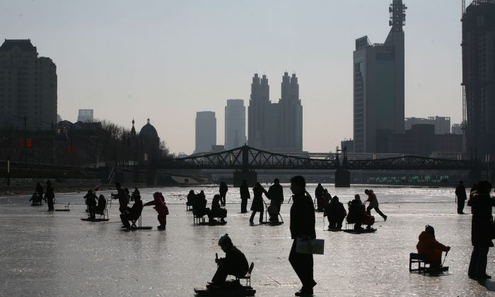 People play on the frozen Haihe River on January 26, 2009 in Tianjin, China. (China Photos/Getty Images)