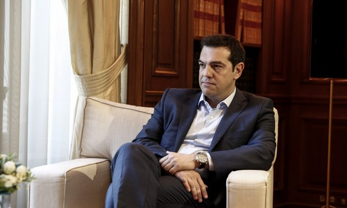 Greece's Prime Minister Alexis Tsipras listens to visiting Austrian Chancellor Werner Faymann in Athens, Greece, on Wednesday, June 17, 2015. Athens must pay 1.6 billion euros ($1.8 billion) off its debts at the end of the month to avoid a possible default and secure its cherished place among the 19 countries using the euro single currency.(AP/Yorgos Karahalis)