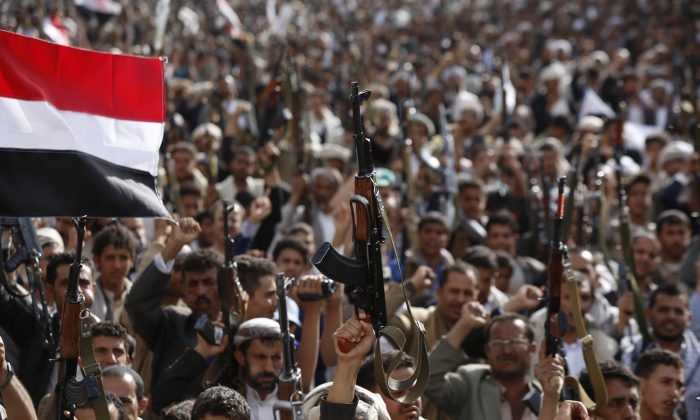 Shiite rebels known as Houthis hold up their weapons as they chant slogans during a rally against Saudi-led airstrikes in Sanaa, Yemen, Sunday, June 14, 2015. Yemeni political groups, including the Shiite rebels known as Houthis, departed from the airport in the capital, Sanaa, on Sunday, to travel to Geneva for U.N.-led peace talks, officials said. (AP/Hani Mohammed)