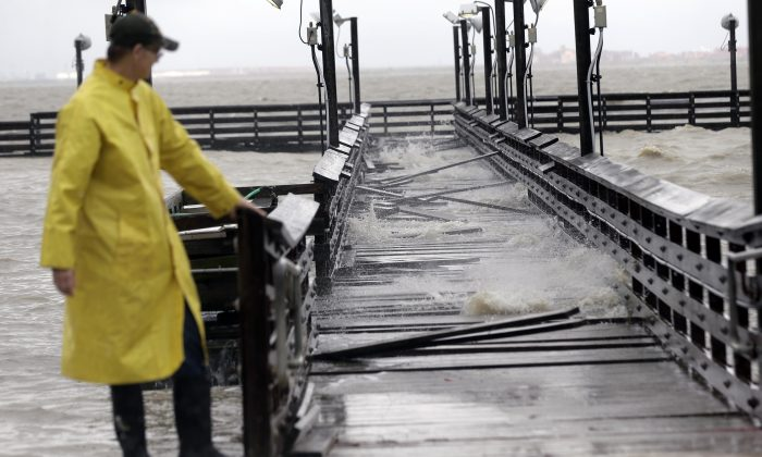 Port Lavaca Mayor Jack Whitlow surveys damage to a park pier as Tropical Storm Bill passes over, Tuesday, June 16, 2015, in Port Lavaca, Texas. The storm came ashore shortly before noon along Matagorda Island with maximum sustained winds of 60 mph, according to the National Hurricane Center in Miami. (AP/Eric Gay)