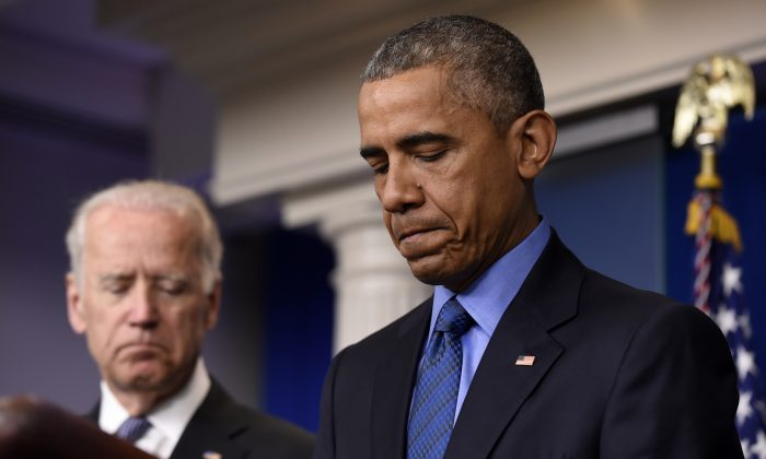 President Barack Obama, accompanied by Vice President Joe Biden, pauses while speaking in the Brady Press Briefing Room of the White House in Washington, Thursday, June 18, 2015, on the church shooting in Charleston, S.C.  (AP Photo/Susan Walsh)