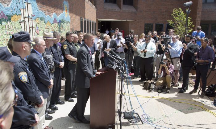 Clinton County District Attorney Andrew Wylie, center, discusses the escape of two prisoners, during a news conference, Wednesday, June 17, 2015 in Plattsburgh, N.Y. David Sweat and Richard Matt escaped the Clinton Correctional Facility in Dannemora, N.Y. 12 days ago. (AP Photo/Mark Lennihan)