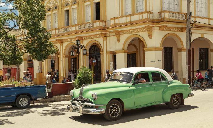 Beautiful green retro car in cuban town. (Vitaldrum/iStock)