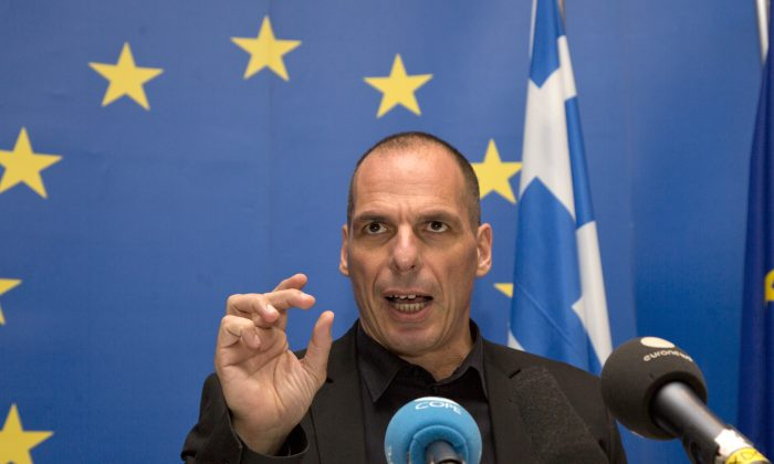 Greek Finance Minister Yanis Varoufakis speaks during a media conference after a meeting of eurogroup finance ministers at the European Council building in Luxembourg on Thursday, June 18, 2015.  (AP Photo/Virginia Mayo)
