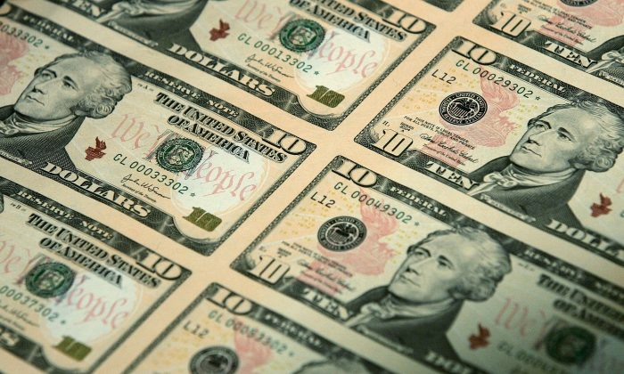 An uncut sheet of the $10 bill. The dollar has been rising in value against every other currency, including gold.  (Alex Wong/Getty Images)